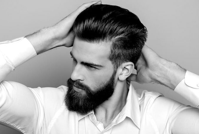 black and white photo of man combing hair